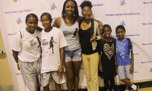 Hollywood hero turned basketball pro donates 700 book bags with school supplies